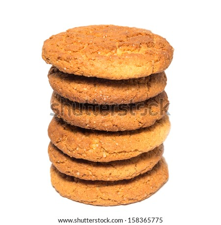 Oat cookies in stack isolated on white.  Selective focus with shallow depth of field. - stock photo