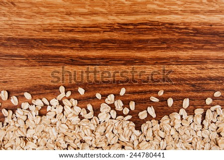 oat corns background on wooden table with place for text - stock photo