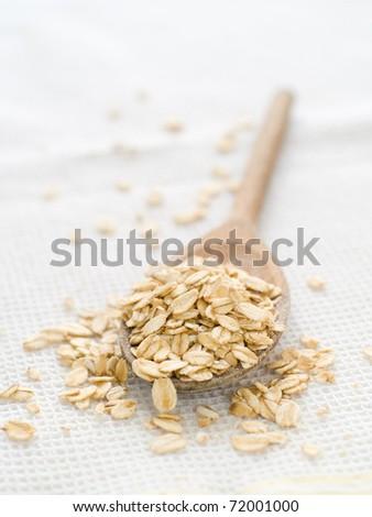 Oat flake  on white kitchen towel - stock photo