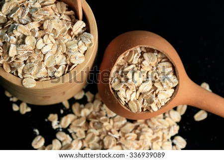 oat flakes black background