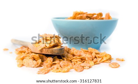Oat flakes in bowl and wooden spoon on white background. - stock photo