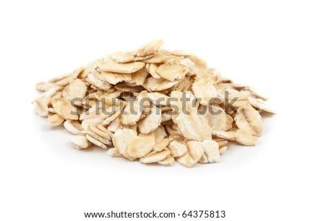 Oat flakes isolated on white background - stock photo