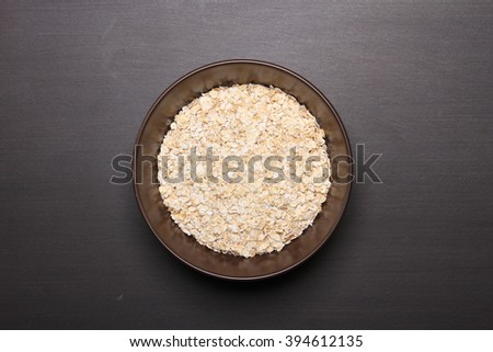 Oat flakes on table.healthy food concept. - stock photo