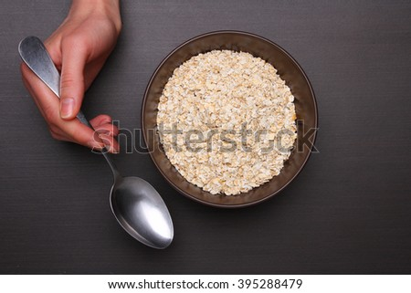Oat flakes on  table. Healthy food concept. Top view - stock photo