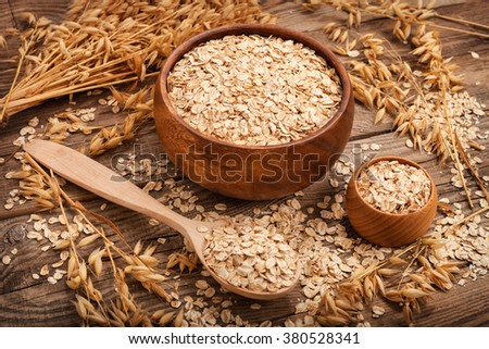 oat flakes on the old board. food concept.