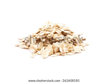 Oat flakes on white - stock photo
