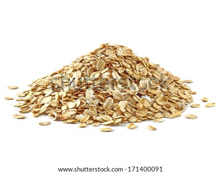 Oat flakes pile on white background - stock photo
