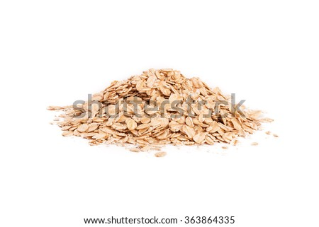Oat flakes pile on white background