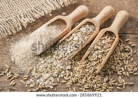 Oat flakes, seeds and bran in spoons - stock photo