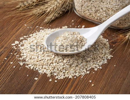 Oat flakes. Selective focus. on wooden table - stock photo