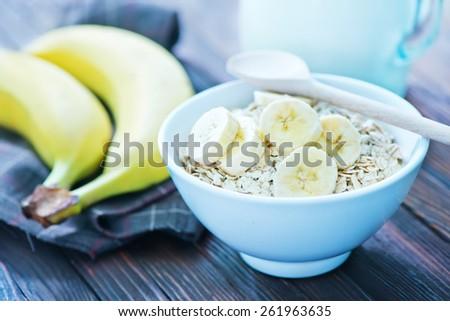 oat flakes with banana - stock photo