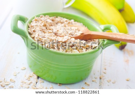 oat flakes with banana and milk - stock photo