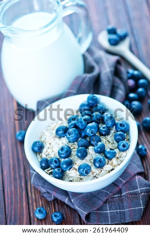 oat flakes with blueberry - stock photo