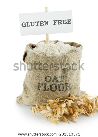Oat flour in small linen sack - stock photo