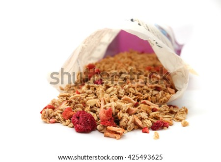 Oat Granola with dried raspberries breakfast cereal from the packaging isolated on white background - stock photo