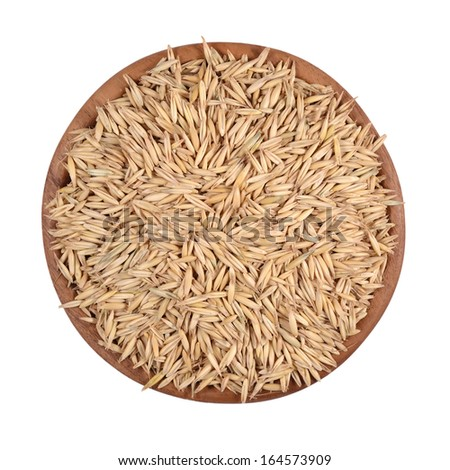 Oat seeds in a wooden bowl on a white background