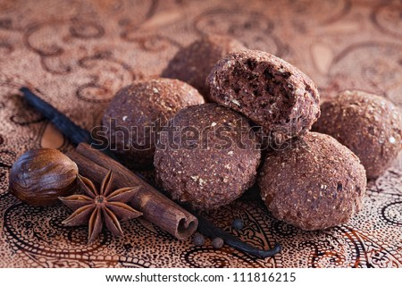 Oatmeal, bran and chocolate cookies with spices, selective focus - stock photo