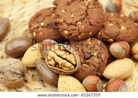 oatmeal cookies and nuts in a wicker mat - stock photo