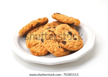 Oatmeal cookies on plate isolated on white background. - stock photo