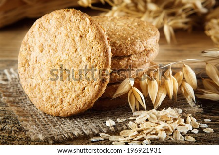 Oatmeal cookies on the wooden table - stock photo