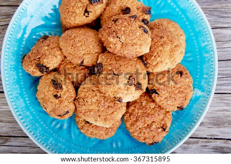 Oatmeal cookies tasty breakfast on the plate on a wooden background