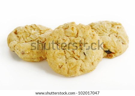 Oatmeal cookies with raisin on white ground