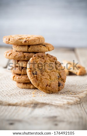 Oatmeal cookies with wooden background.