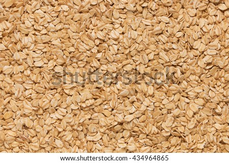 Oatmeal flakes close up as background. Close up of porridge oats as background or texture. Diet and healthy nutrition.