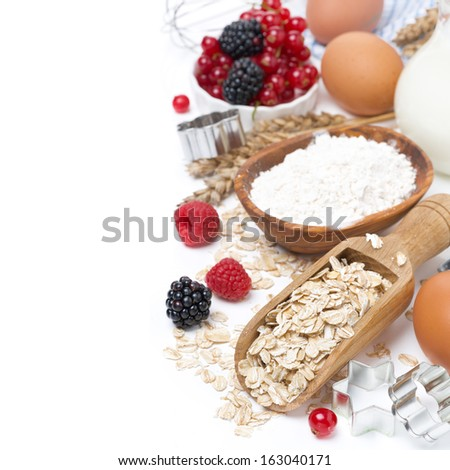 oatmeal, flour, milk, eggs and berries - the ingredients for baking cookies, isolated on white - stock photo