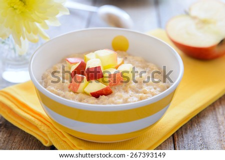 Oatmeal gruel with apples - stock photo