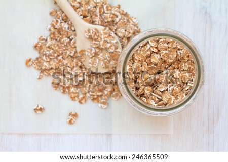 Oatmeal on a vintage wooden background - stock photo