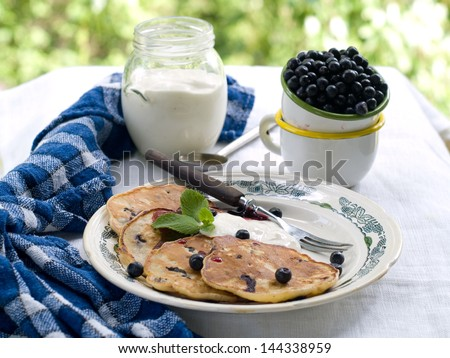 Oatmeal pancake with blueberry, selective focus - stock photo