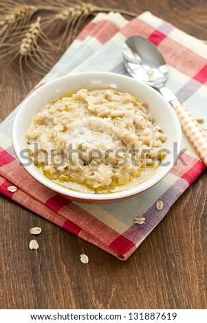 Oatmeal porridge - stock photo