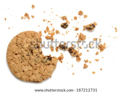 oatmeal raisin cookie with crumbs white background - stock photo