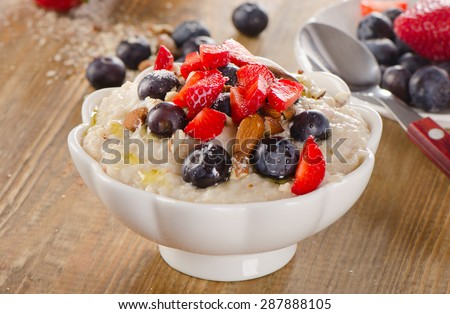 Oatmeal with Berries and nuts  for a Healthy Breakfast. Selective Focus - stock photo
