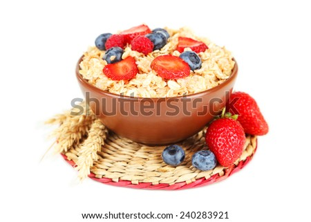 Oatmeal with berries isolated on white - stock photo