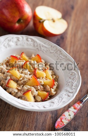 Oatmeal with caramelized apples, selective focus - stock photo