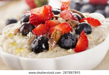 Oatmeal with fresh Berries and nuts  for  a Breakfast. Selective Focus