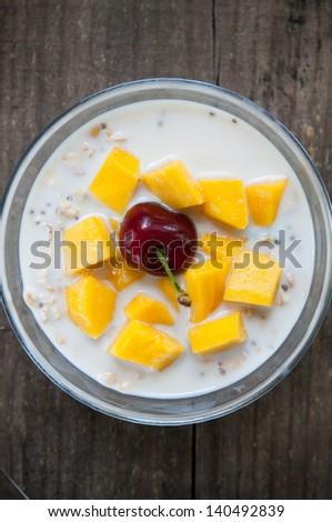 oatmeal with fresh mango & cherry - stock photo
