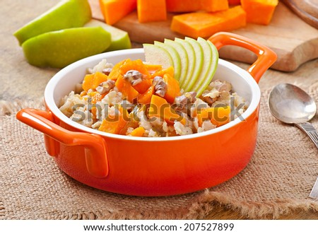 Oatmeal with pumpkin, apples, nuts and honey - stock photo