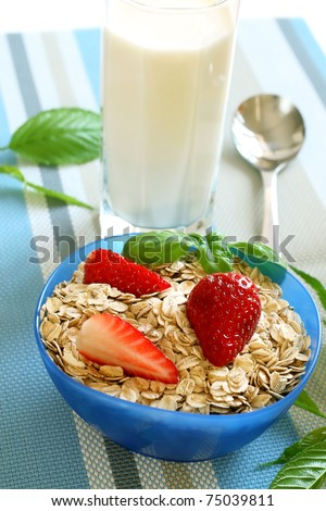 oats and strawberry in bowl and glass of milk, diet breakfast - stock photo