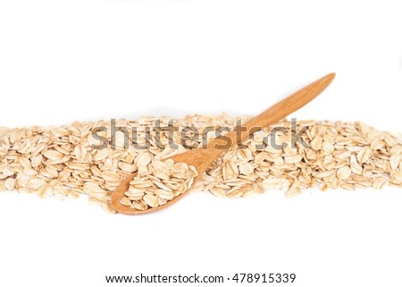 Oats flakes pile in wood spoon on white background