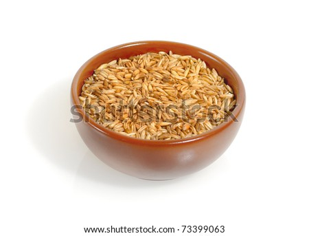 Oats grains in the bowl isolated on a white background. Cereals oats - healthy breakfast for the fitness meal. - stock photo