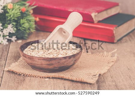 oats in plate on wood table with vintage tone