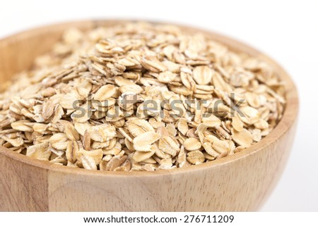 oats in wooden bowl