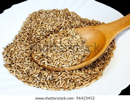 Oats seed in plate isolated over black