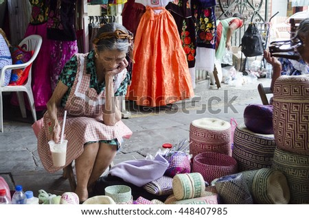 OAXACA MEXICO- MARCH 21, 2016: Woman resting with typical handicraft in a market in Oaxaca, Mexico - stock photo