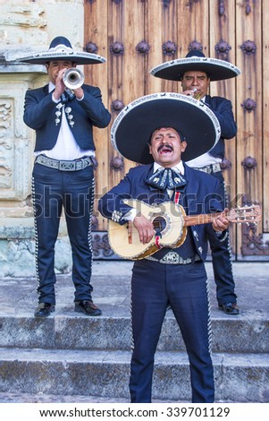 OAXACA , MEXICO  - NOV 02 : Mariachis perform during the carnival of the Day of the Dead in Oaxaca, Mexico, on November 02 2015. The Day of the Dead is one of the most popular holidays in Mexico - stock photo