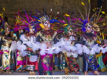 OAXACA , MEXICO - NOV 02 : Unidentified participants on a carnival of the Day of the Dead in Oaxaca, Mexico on November 02 2015. The Day of the Dead is one of the most popular holidays in Mexico - stock photo