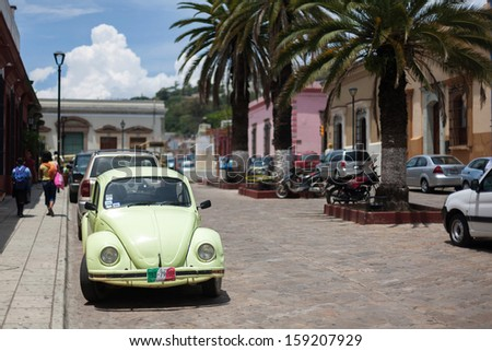 OAXACA, MEXICO - SEN 08: Old cars on the street of Oaxaca, Mexico, 08 September 2012. The city architecture of Oaxaca is protected by UNESCO - stock photo